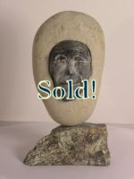 Inuit sculpture - face in stone
